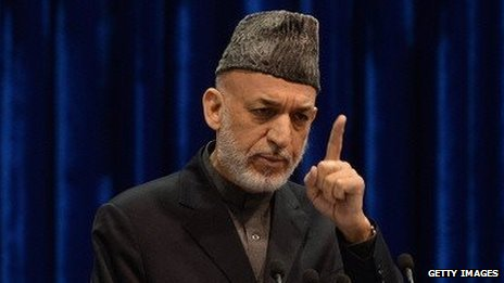 Afghan President Hamid Karzai speaks to the loya jirga on November 24, 2013.