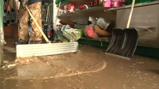 Floodwater is swept from a room