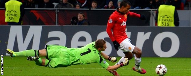 Nani of Manchester United rounds Bernd Leno of Bayer Leverkusen to score their fifth goal