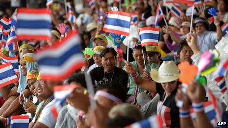 Anti-government protesters wave national flags during a protest at Government Complex in Bangkok on 28 November 2013