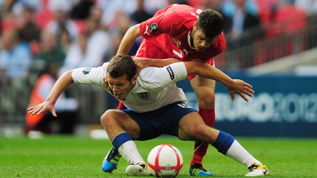 Jack Wilshere tackled by Swiss player
