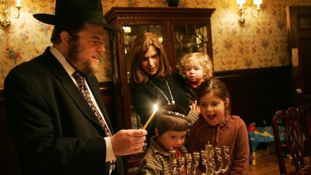 A Rabbi celebrating Hanukkah with his family
