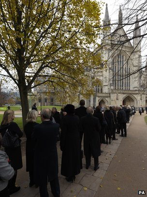 Mourners gather outside Winchester Cathedral for Sir John Tavener's funeral