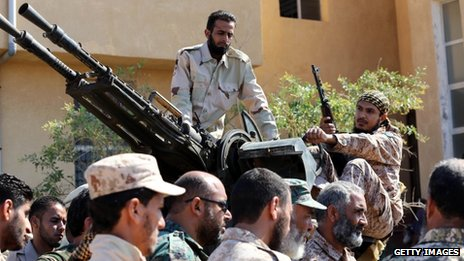 Members of Libya's shield brigade are seen at a base in Tripoli