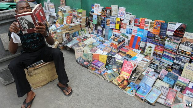 A bookseller on a street in Lagos Nigeria