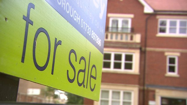 A 'for sale' sign outside a property