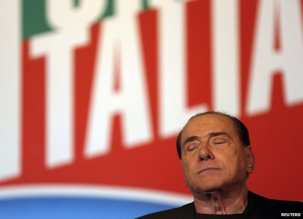 Silvio Berlusconi closes his eyes while addressing supporters in Rome, 27 November