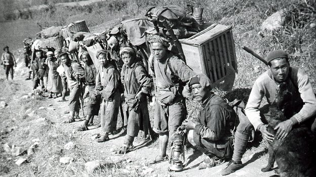 Porters carrying luggage