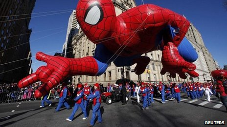 Spider-Man balloon floats down Central Park West during the 87th Macy's Thanksgiving Day Parade in New York on 28 November 2013