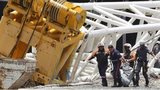 Firefighters recover the body of a worker who was killed when a part of the Itaquerao stadium collapsed, in Sao Paulo, Brazil