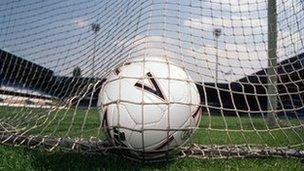 Football in back of goal