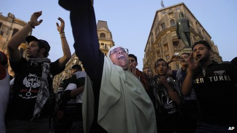 Egyptian protesters chant slogans during a protest in Talaat Harb Square in Cairo, Egypt, against the issuance of a new law regulating demonstrations, Thursday, Nov. 28, 2013.