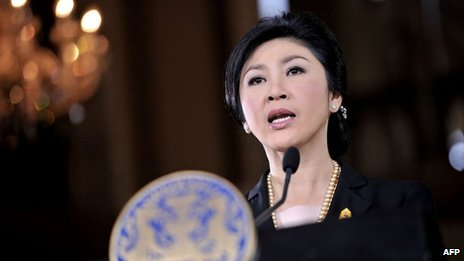This handout picture taken and provided by the Thai Government on 28 November 2013 shows Thai Prime Minister Yingluck Shinawatra addressing reporters during a press conference at Government House in Bangkok