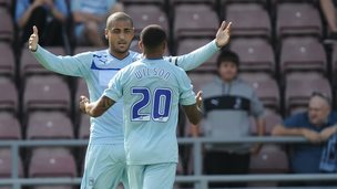 Leon Clake and Callum Wilson celebrate at Sixfields
