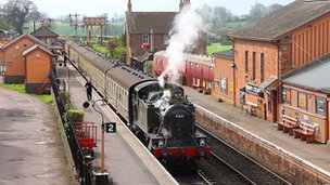 Steam train going through West Somerset Railway line.