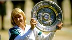 Martina Navratilova holds up the winners' plate at Wimbledon in 1987