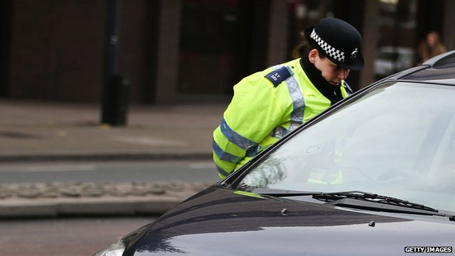 Police officer questioning driver