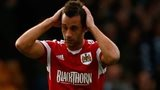 Bristol City's Sam Baldock and Aden Flint walk off the pitch
