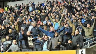 Coventry fans celebrate Aaron Phillips' late equaliser at Molineux in October