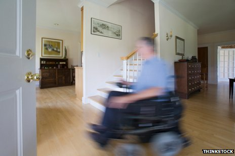 wheelchair user in a blur