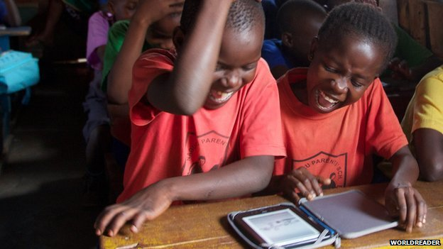 Children in Africa reading an e-book produced by the organisation Worldreader