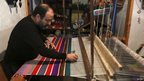 A man making a blanket on a loom in Tripoli, Libya - Thursday 28 November 2013