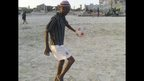 A old man playing playing football on a beach in Mogadishu, Somalia - Thursday 28 November 2013 (Photo taken by the BBC Mohamed Moalimu)