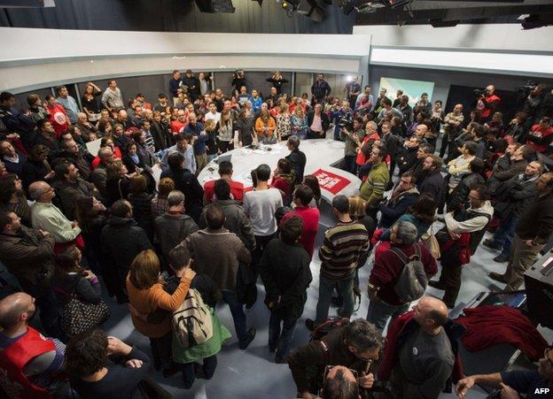 Staff gather inside RTVV in Valencia, Spain, 29 November