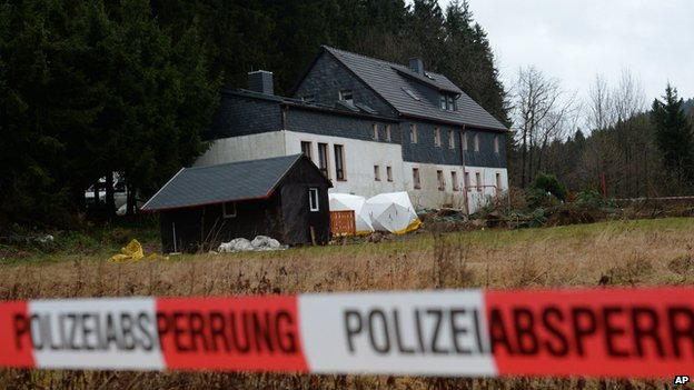 Police cordons block a property near Reichenau, eastern Germany Friday Nov. 29, 2013