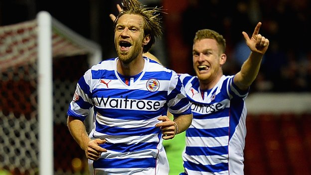 Reading defender Kaspars Gorkss celebrates his goal