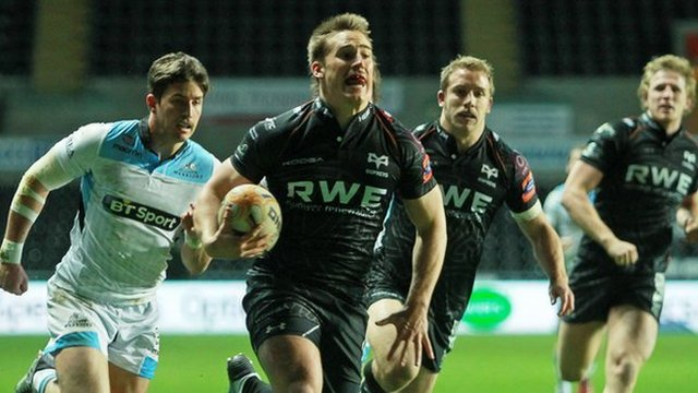 Jeff Hassler runs in the Ospreys' opening try in the Pro12 against Glasgow at Liberty Stadium