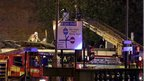 Firefighters at Glasgow pub helicopter crash scene