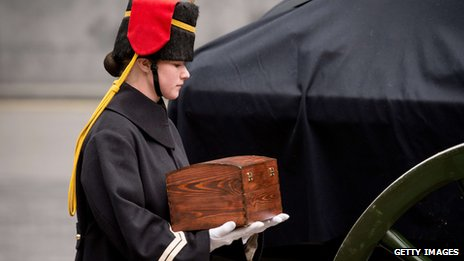 "A member of the Household Cavalry Mounted Regiment carries a ceremonial casket of ""sacred soil"" from First World War battlefields"