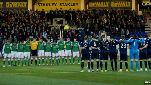Ross County and Hibs players hold a minute's silence