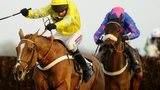 Barry Geraghty riding Triolo D'Alene (l) to win The Hennessy Gold Cup Steeple Chase