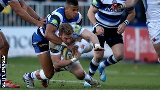 Matt Jess is tackled by Anthony Watson