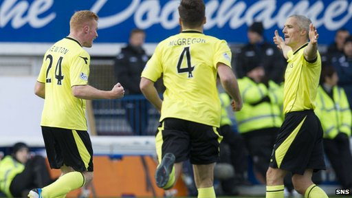Conor Newton (left) celebrates after opening the scoring for St Mirren