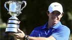 Northern Ireland's Rory McIlroy holds the trophy after his one-shot win over Masters champion Adam Scott at the Australian Open