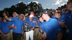 Rory McIlroy celebrates with green staff after his victory at the Australian Open