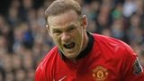 Wayner Rooney celebrates his penalty for Manchester United