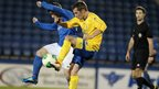 Shane McCabe of Glenavon battles for possession against Dungannon Swifts opponent Jonathan Topley