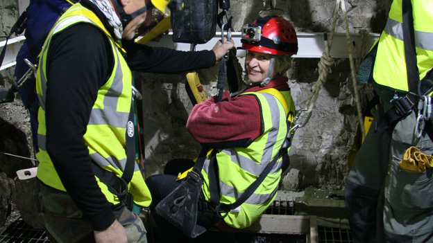 Lesley Woodbridge being lowered into the shaft