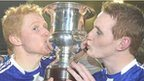 Coilin and Aaron Devlin celebrate Ballinderry's triumph in the Ulster Club final