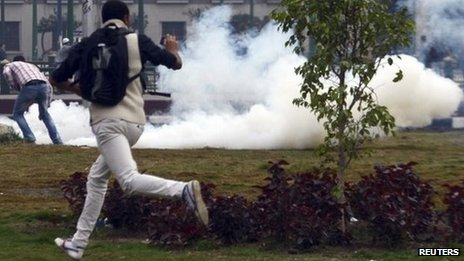 Protester and tear gas, Tahrir 1/12/13