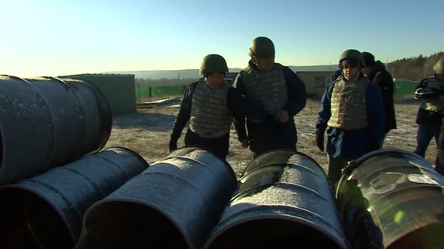 Civilian chemical weapons inspectors in training