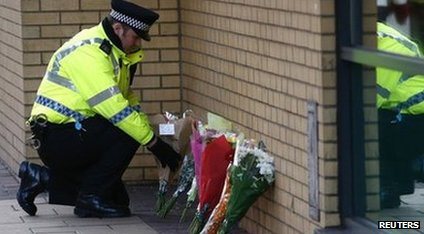 Flowers laid near the scene of the helicopter crash