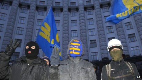 Protesters stand in front of Ukraine's main government building in Kiev, on 2 December.