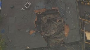 The hole left in the building after the helicopter was removed.