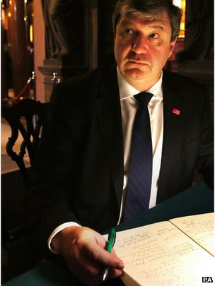 Scottish Secretary Alistair Carmichael signs a book of condolence