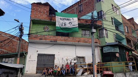 A flag marks the entrance to Barrio Pablo Escobar in Medellin, Colombia